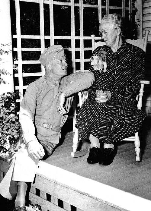 Dwight Eisenhower at his mother's knee. The Supreme Commander of the Allied Expeditionary Forces, came back to Abilene, Kansas for a visit following Germany's surrender in May 1945. June 24, 1945. (CSU_ALPHA_291) CSU Archives/Everett Collection