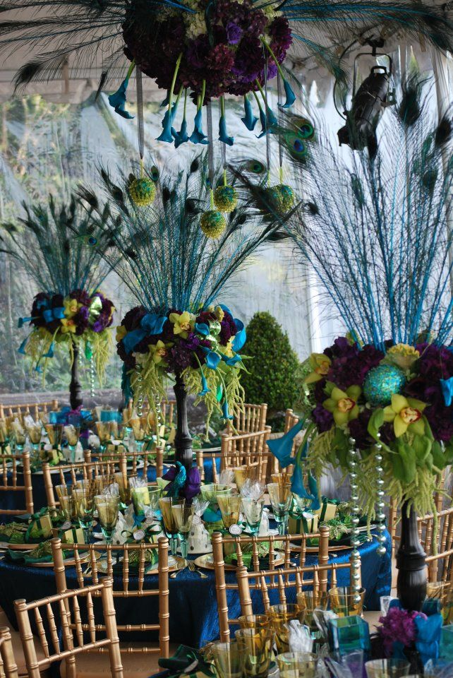 lovely peacock centerpieces http://www.isabellasdesigns.com/ ( she also has a facebook account with tons of pics