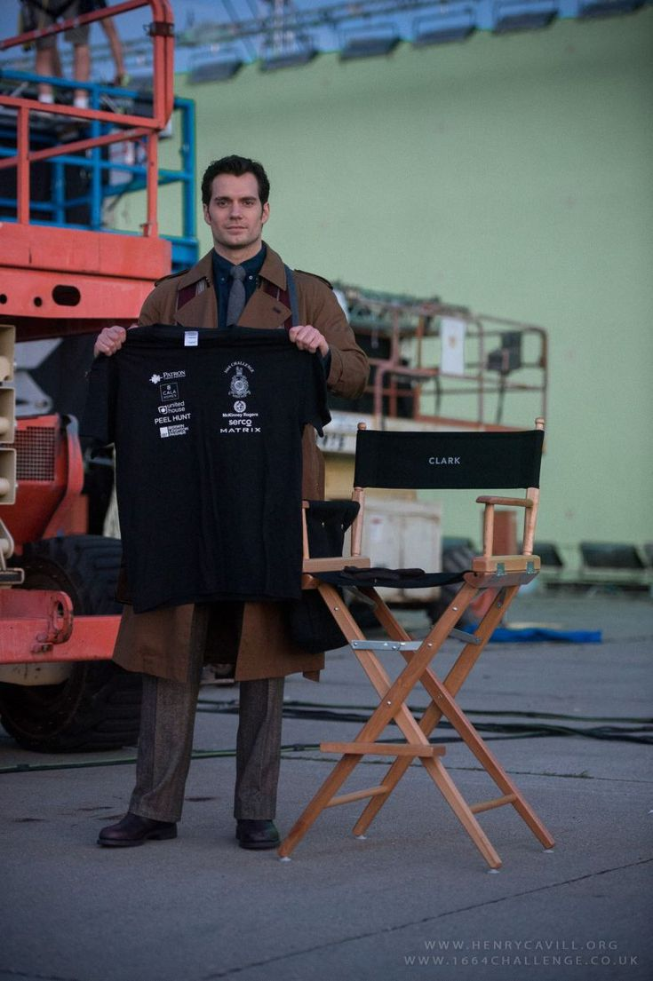 "First look at Henry Cavill as Clark Kent in ""Batman v Superman: Dawn of Justice."" Technically he's promoting a trust fund for wounded veterans that he represents but IT'S ON SET AND LOOK AT THE COSTUME. He's channeling the Tenth Doctor with that trench coat! @emilybarber96 @Abigailgermo @scarletflower89"