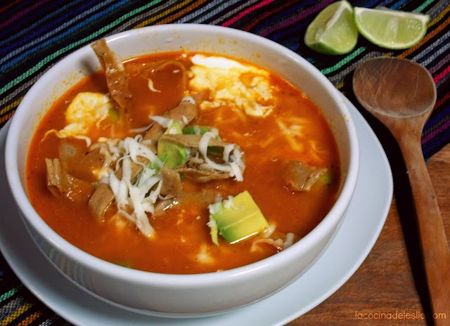 Mexican Tortilla Soup - made by toasting tomatoes and dried ancho chilies