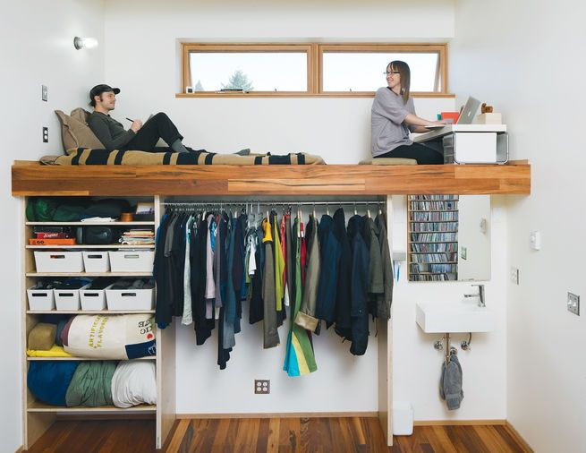 """This cozy Portland home is a lesson in efficiency. The lofted bed and workspace rise above a compact sink and closet area. """"People ask us, 'What did you do to make your house not feel like this cramped little thing?' with the idea that the house is trying to act big,"""" says resident Katherine Bovee. """"It's not. It's a small house acting like a small house. We built the house to fit in its own skin."""" Photo by: John Clark"""