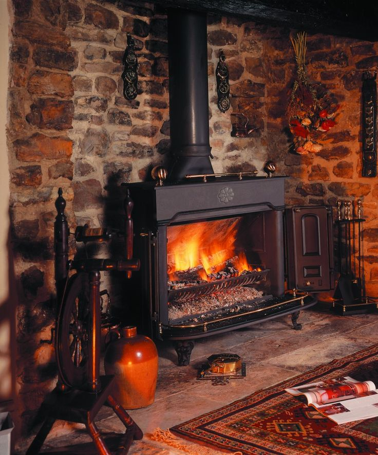 Fireplace, : Classy Country Rustic Living Room Design Using Freestanding Black Metal Fireplace Along With Flueless Wood Burning Stoves And Grey Stone Fireplace Surround
