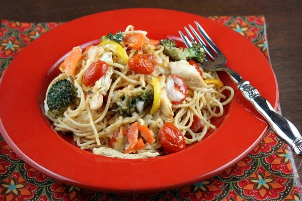 Baked Lemon Chicken Spaghetti Primavera -----~This pasta is baked with loads of lightly sauteed vegetables, lemon, Barilla Whole Grain pasta a light sauce and a sprinkling of cheese too.