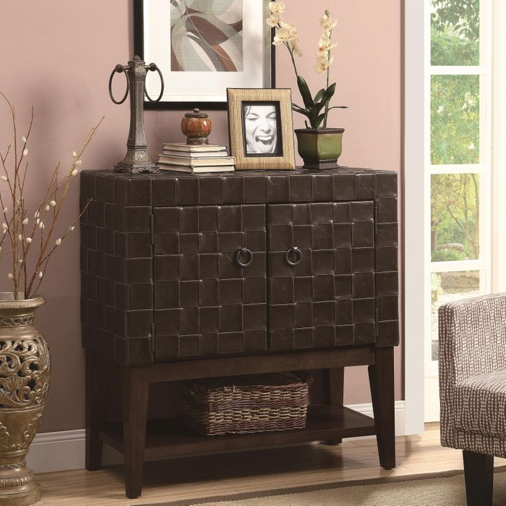 This Unique Accent Cabinet Features A Woven Leather Like Vinyl Exterior Giving This Piece A