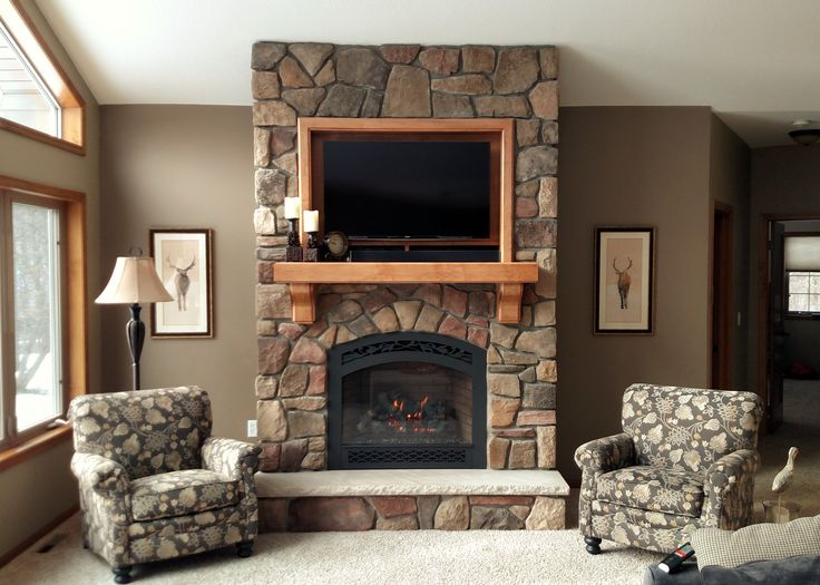 "Add beautiful texture to your home using stone. Here we installed Cultured Stone's ""Dressed Fieldstone"" in Chardonnay around Fireplace Xtrordinair's ""864"" with French Country Face. We built a custom maple mantel and TV nook to complete the look."