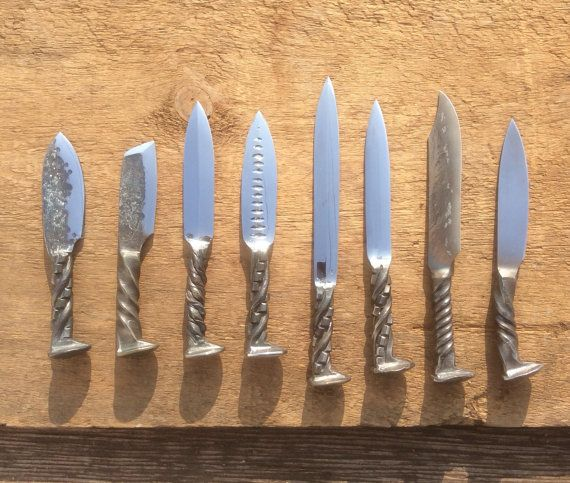 Hand Forged Rail Road Spike Knives by TimsSatchels on Etsy Mitchell polishes everyone of these knives by hand.