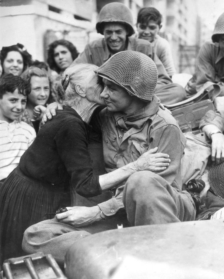 An Italian woman shows her gratitude to an American soldiers following the liberation of Rome, via Getty Images (January 1945)