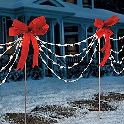 Make with PVC pipe, bows, lights. Rebar in ground.
