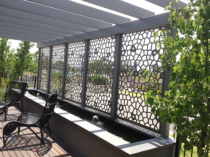 Decorative screens create privacy and shade for patios, decks, balconies, or wherever needed and come in many different designs, materials, and sizes. This is QAQ's 'Utah' design in compressed hardwood. ~QAQ