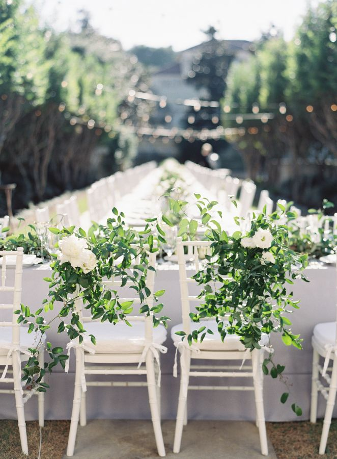 Southern outdoor greenery wedding table that is #goals! http://www.stylemepretty.com/texas-weddings/austin/2017/01/12/this-wedding-will-make-you-fall-ever-so-hard-for-green-garland/ Photography: Mint - http://mymintphotography.com/