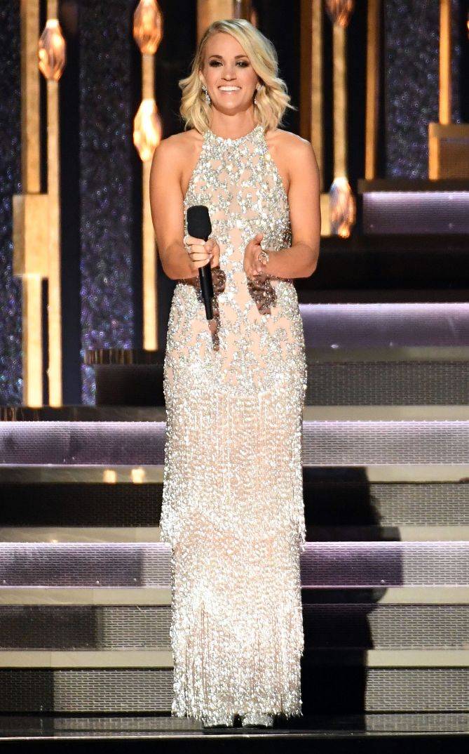 Carrie Underwood in a silver beaded Jovani dress - click through to see all of her 2016 CMAs looks!