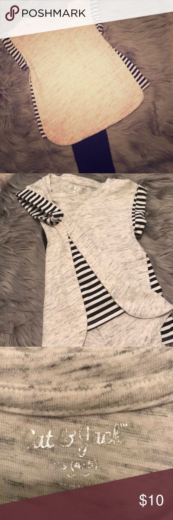 Gray wash tee with black and white stripes Gray wash tee with black and white striped sleeves and stripes down side of shirt. Excellent condition! Smoke free home. No stains, rips, or fading. Super cute with leggings and black glitter high tops! Shirts & Tops Tees - Short Sleeve
