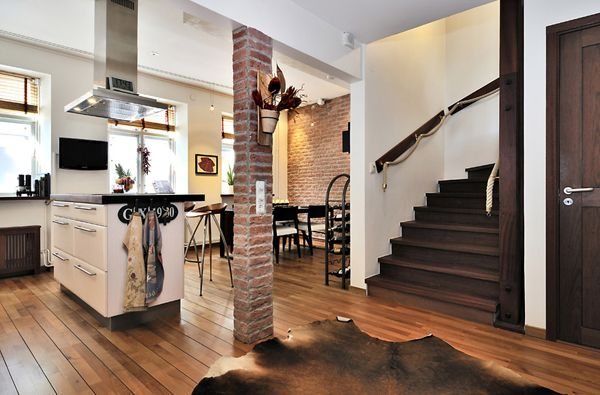 kitchen with exposed brick wall