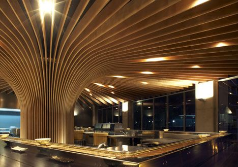 Interior turning upside down to create shelving form ceiling TREE Restaurant by Koichi Takada Architects