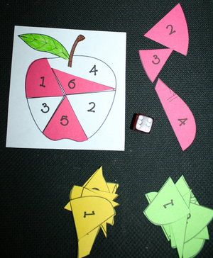 Apples on a roll dice game.  FREE printables.  going to make this my self!