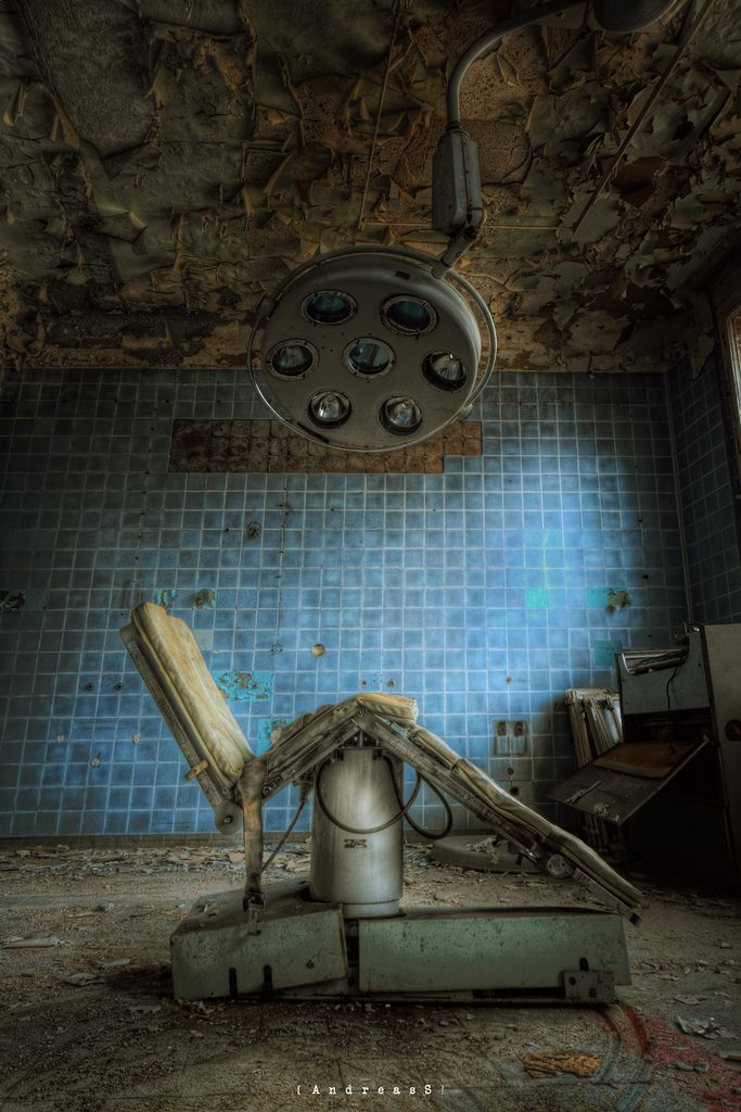 Abandoned operating lamp and chair, abandoned hospital - Germany...this is ultra creepy!!!