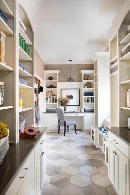 A hexagon tile floor adds pattern in the pantry and complements the hickory wood floor in the adjacent kitchen.