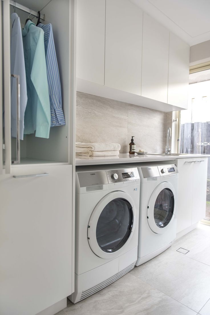 Red Lily Renovations - Perth.  White Laundry.  Clothes hanging cupboard with pull out laundry basket.  Condenser drier.  White stone benchtop.