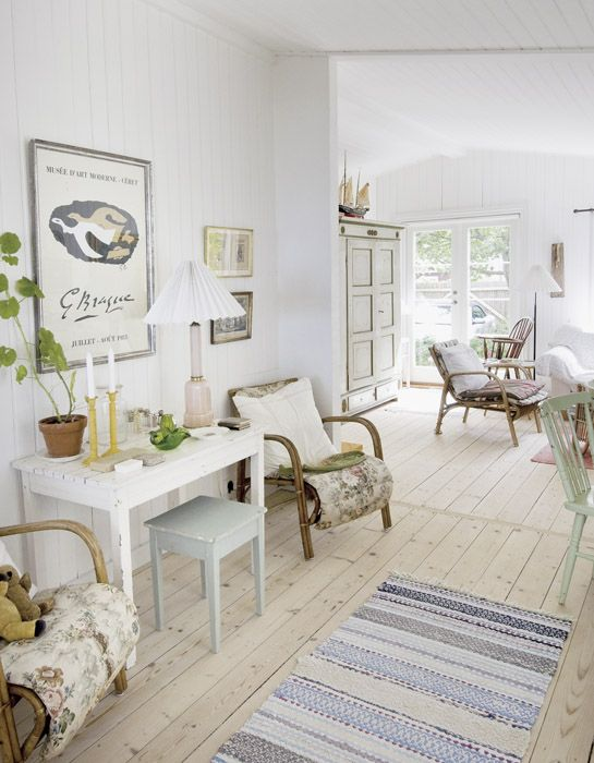 Pale floorboards set the tone and anchor this light, breezy, incredibly pretty space