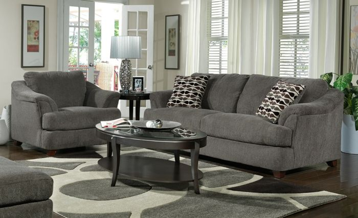 Couchtisch oval grau teppich grau sofa