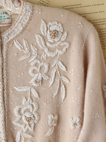 Beaded beige cardigan with embroidery in the front