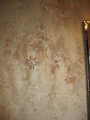 This finish done with Lusterstone has a delicate relief pattern with jewel details. Heather shows you that a partial stencil pattern may be effective. This is a favorite pattern, Large Flourish, from Royal Design Studio, that I have used on several projects myself.