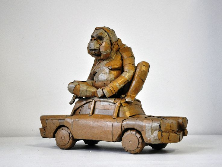 An orang outang on a car. Work by Laurence Vallières