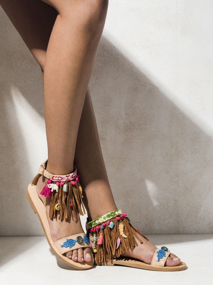 Handmade from fine greek leather, these sandals feature a leather fringe, teeny tiny hot pink pom poms, neon tassels made by hand, macrame friendships and semi-precious stones.  http://www.elinalinardaki.com/shoes/sandals/all-time-classics/sandal-castaway/