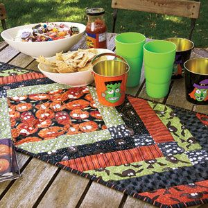 Monster Munchies: FREE Halloween Table Runner Quilt Pattern    I'm thinking Chirstmas fabric for a few pressies. That way I can make a few and might get the hang :)