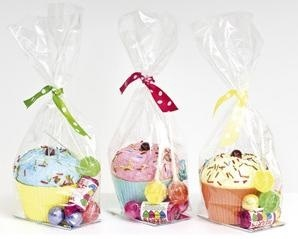 These paper mâché cupcakes make great table favours, party bags or token gifts.  Presented in cello bags with coloured polka dot ribbon.  Filled with a mix of yummy sweets including fruit lollies, love hearts and milk chocolate balls.  £6.99 each and can be ordered online at the Fuschia Boutique at www.fuschiadesigns.co.uk.