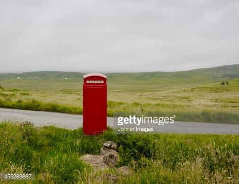 Stock Photo : Telephone booth on side of country road