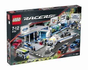 "LEGO Racers Brickstreet Customs by LEGO. $199.95. The workshop includes working car lift to inspect the car, spare tires, engine and more. The gas station has a drink machine, gas pumps, tire and oil cans. The tractor trailer measures 13"" (33cm) long; the racers measure 3"" (8cm) long. Contains 1,019 pieces. Includes seven tiny turbo racers and a flatbed transport truck with car-carrying trailer. From the Manufacturer                Customize your ride. Get you..."