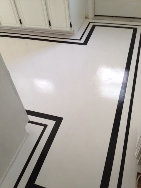 Painted floor mostly white with black line trim