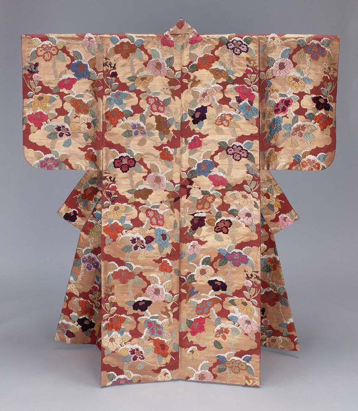Dark red silk Noh theater robe (karaori) for female role with an overall design of snow-covered camellia branches and birds in gold, blue, red, pink, green and white silk discontinuous supplementary patterning wefts with a background of stylized clouds in gilt paper discontinuous supplementary patterning wefts; dark blue plain-weave silk lining.