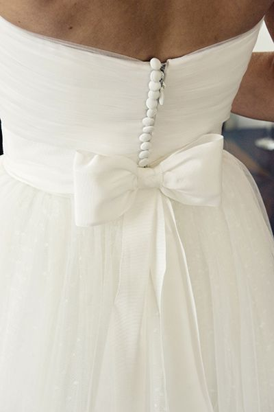 Bow on the back of the dress. Would love to use material from my moms dress to do this.