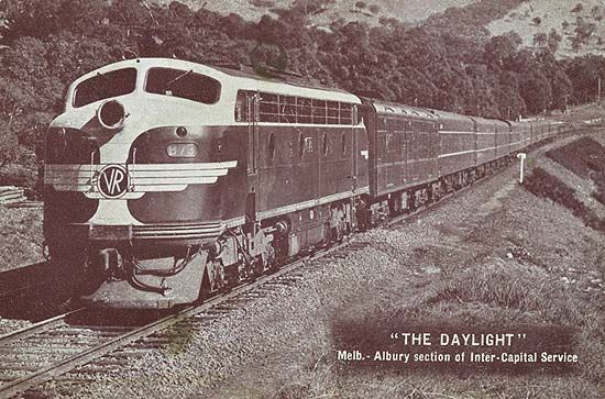 The Daylight, Melbourne-Albury section of Inter-Capital service, post 1930. Inscription: The Daylight. Melb.-Albury Section of Inter-Capital Service. Description: Diesel engine with passenger carriages attached. Engine has Victorian Railways logo on front. Engine No. B 73. Location: Victoria, Australia Date: post 1930. This was well before the use of through carriages from N.S.W. introduced in 1962.