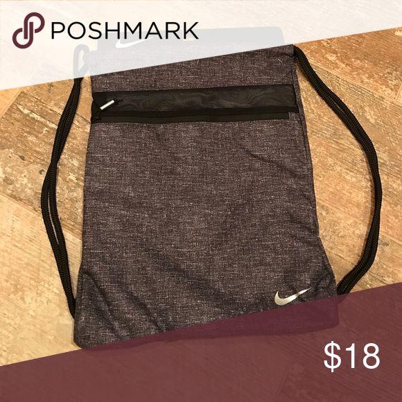 Nike Sport Gym Sack III Black denim-like pattern on a lightweight cinch/gym sack for multi purposes.  Also includes front zip deep pocket in black trim. Nike Bags Backpacks