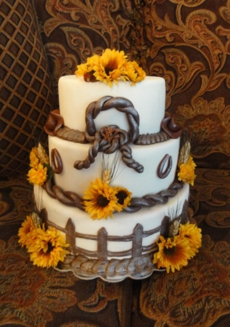 Okay i love this cake to darn cute and would so go with the wedding theme one of the best cakes I've seen on here.