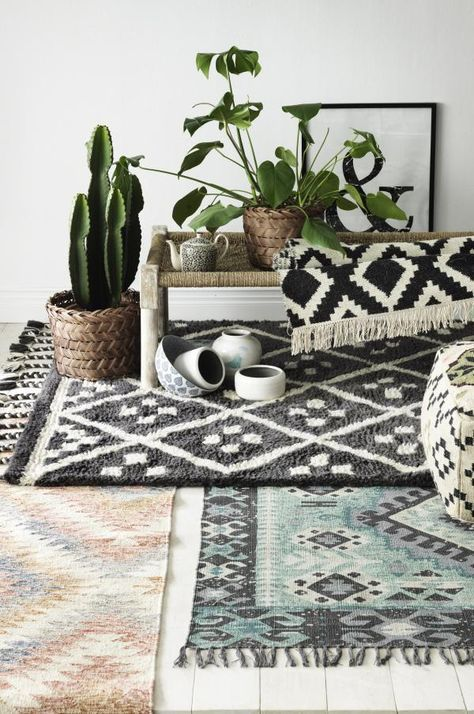 Layered rugs are a trend! Get a bolder look and highlight your house with some contemporary rug styles. How may layers can you see??