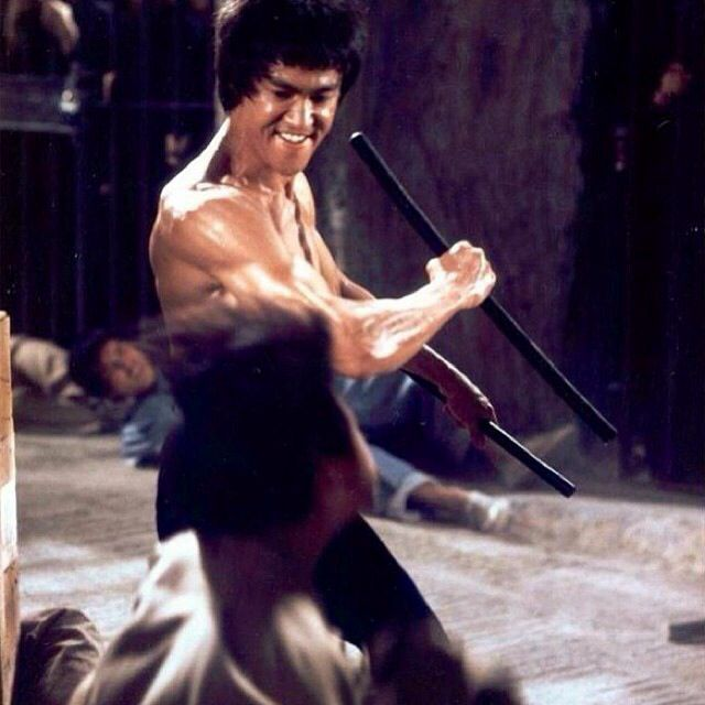Bruce Lee - name this movie ;) this is the dungeon scene from Enter The Dragon. See the Philippine Fighting Sticks in Bruce' hands.