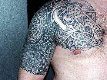 This is a gorgeous tattoo sleeve. I love the negative space on the front of the shoulder. I wish I had other views. Tremendous!