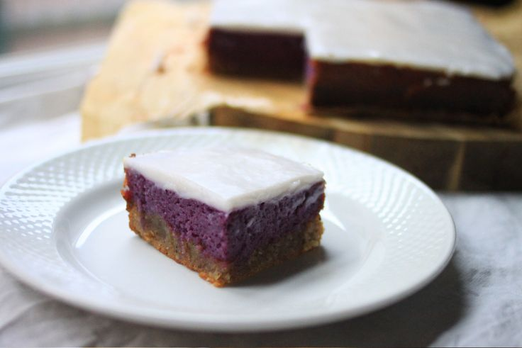hawaiian purple sweet potato pie bars with a haupia (coconut) creamy topping all on a gluten free crust