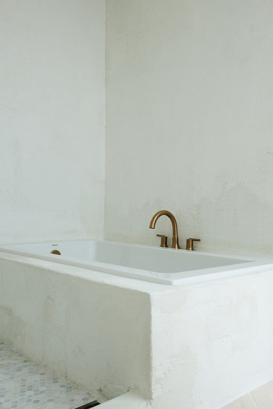 Concrete Wall Finish In The Bathroom Leanne Ford Bath Tub With Gold Hardware