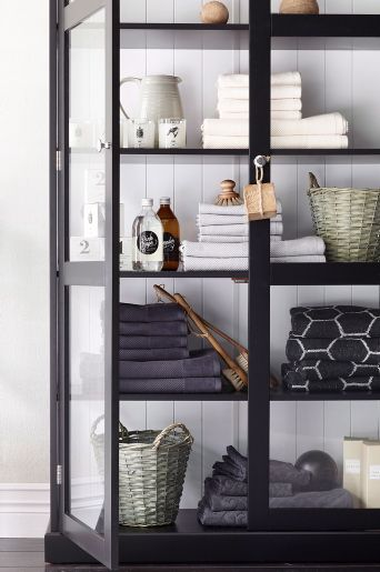 Use a bookshelf or similar shelving unit to organize towels and other bathroom items.