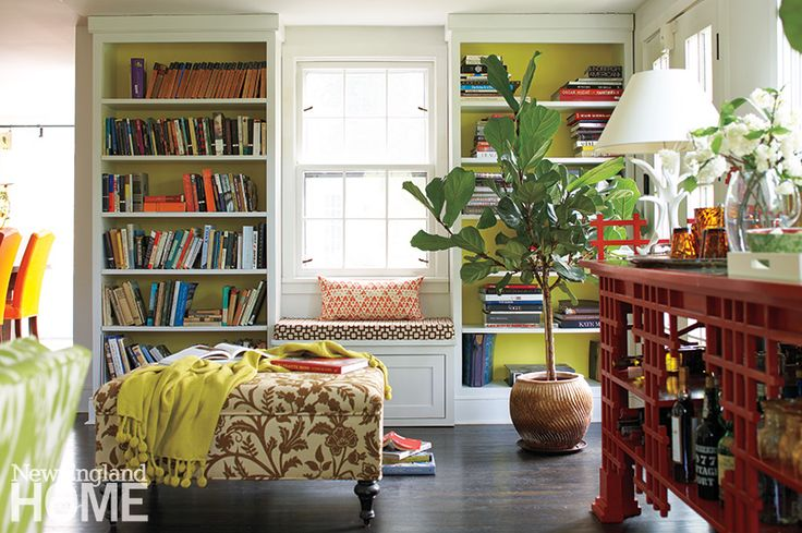 Homeowner Susanna Salk painted the backs of her shelves chartreuse to make the books pop.