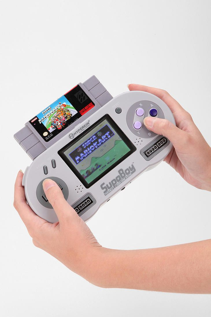 SHUT UP! You can play old school Super Nintendo games on this- Supaboy Portable Game Console--WANT! kind of. It and an actual SNES w/ games is about the same price.