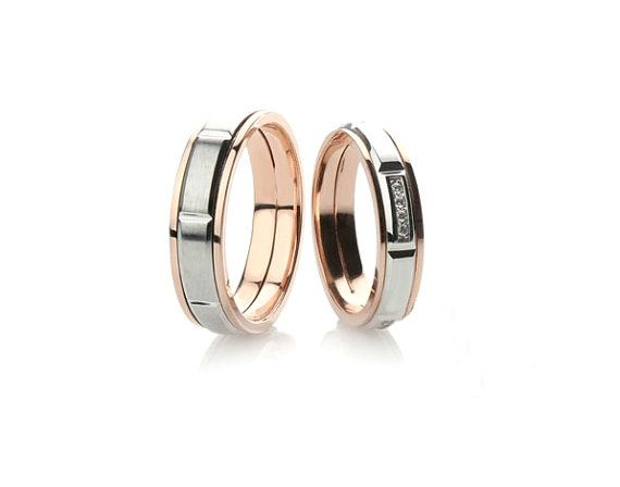Stylish two colored wedding bands. The price is for pair of rings.  - 14k gold - her ring 5 mm wide and his ring 6 mm wide (you can change the ring parameters) - Cubic zirconia (color can be chosen)  Free gift box.  Express shipping with DHL (3-6 business days).  If you want to replace cubic zirconia with other precious stones - please write us and well calculate the cost with the gems you want.  See more at our shop https://www.etsy.com/shop/JewelryEscorial  Join our instagram account…