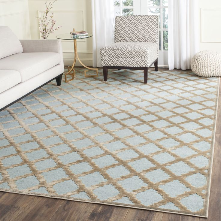 Safavieh's Paradise collection is inspired by timeless contemporary designs crafted with the softest viscose available. This rug is crafted using a power-loomed construction with a viscose pile and fe