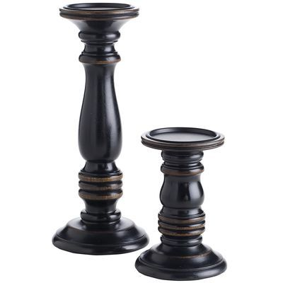 Every room can benefit from a touch of black. It's like eyeliner. :-) These inexpensive candle holders would make a great impact on a coffee table. Place the taller one on top of a small stack of books and add thick, neutral-colored candles for instant charm and warmth.  Black Wooden Pillar Holders