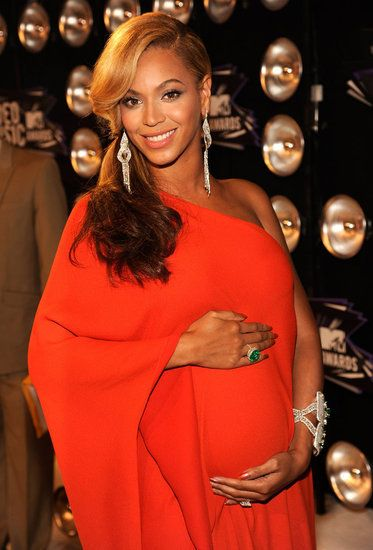 "Beyoncé stepped out in a bright orange Lanvin gown on the Video Music Awards red carpet. She made her official pregnancy announcement that same night during a performance of her hit, ""Love on Top."""